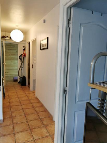 couloir d'accès coin montagne,wc, bain et les 2 chambres